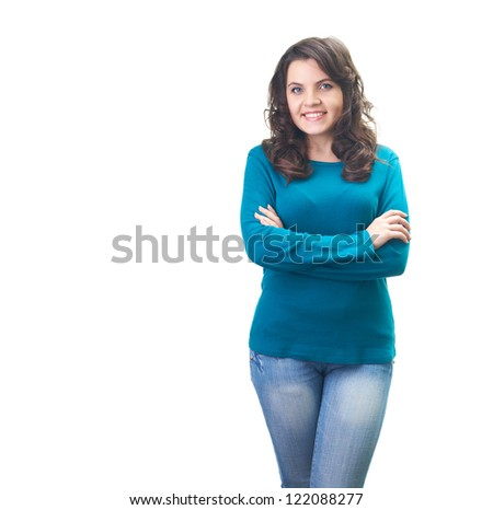Attractive smiling young woman in a blue shirt stands with folded hands. Isolated on white background