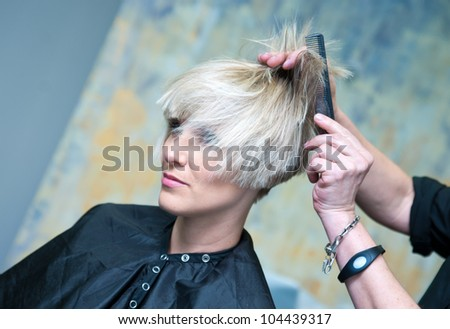 attractive woman having new hairstyle in salon