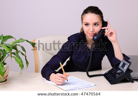 attractive woman in the office making a call