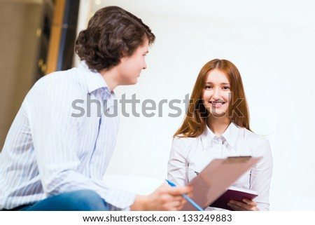 Attractive woman talking with a man, close up portrait