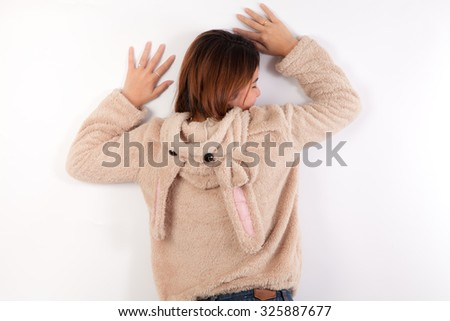 Attractive Young asian woman in Brown coat with rabbit hat,white background