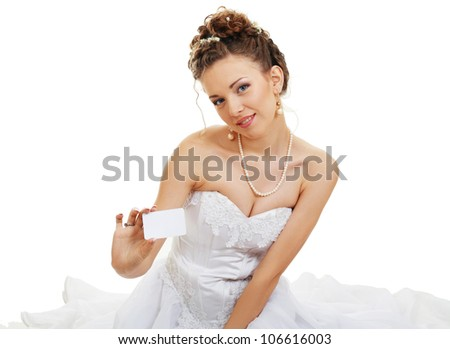 Attractive young bride holds out empty business card or creditcard
