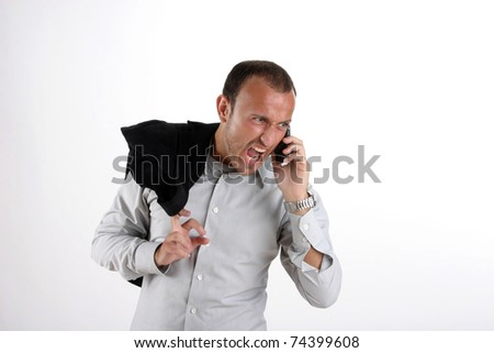 attractive young businessman using a cell phone