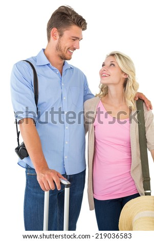 Attractive young couple ready to go on vacation over white background
