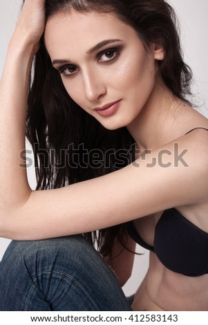 Attractive young girl posing in the studio.