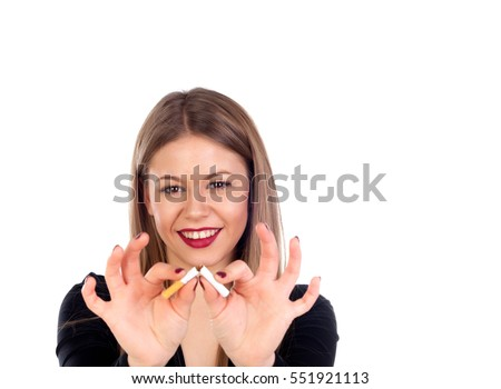 Attractive young woman breaking a cigar isolated on a white background