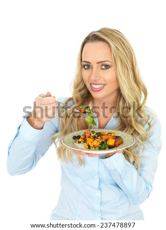 Attractive Young Woman Eating a Roast Vegetable Salad