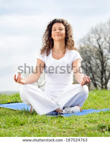 Attractive young woman in a lotus position