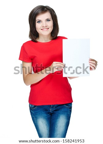 Attractive young woman in a red shirt. Holds a poster. Isolated on white background