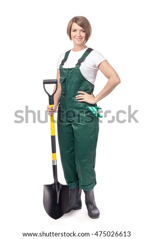 attractive young woman professional gardener in green workwear with shovel isolated on white background. gardening service and business concept