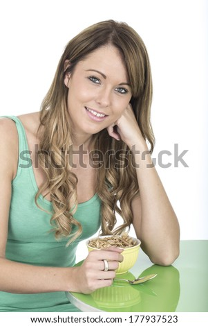 Attractive Young Woman With Breakfast Cereals