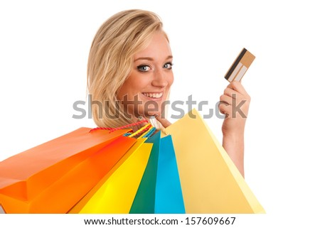 Attractive young woman with colorful shopping bags and golden credit card