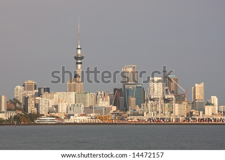 Auckland city lit by early morning sunshine