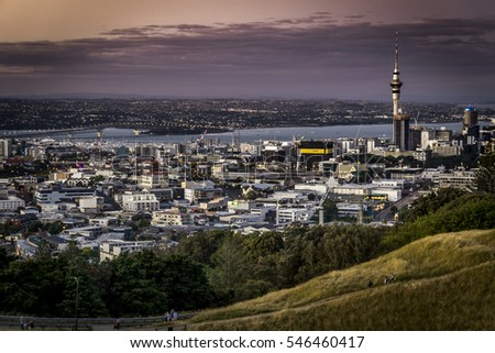 AUCKLAND, NEW ZEALAND - JANUARY 01: A view to the Auckland City and Sky Tower from Mount Eden on January 01, 2017. Auckland is the largest and most populous urban area in New Zealand.
