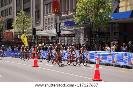 AUCKLAND-OCT. 20: Women participants in the ITU World Triathlon Grand Final Series cycle the main street of downtown Auckland. on Saturday, Oct. 20, 2012.