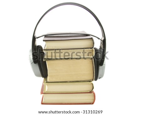 audiobook conception with headphones and books isolated ober white