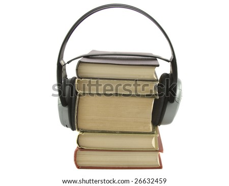 audiobook conception with headphones and books isolated over white
