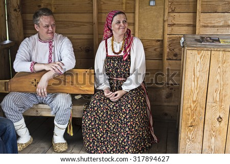 AUG 7, 2015, SUZDAL, RUSSIA - Russian man musician and singer womal in traditional clothes