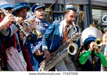 AURILLAC, FRANCE - CIRCA AUGUST 2010:  Aurillac International Street Theater Festival, fanfare in street show, circa august 2010, in Aurillac,France.