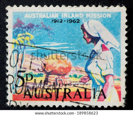 AUSTRALIA - CIRCA 1962:A Cancelled postage stamp from Australia illustrating 50th anniversary of foundation of Australian inland mission, issued in 1962.