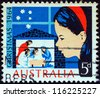 "AUSTRALIA - CIRCA 1964: A stamp printed in Australia from the ""Christmas "" issue shows a child looking at Nativity Scene, circa 1964. - stock photo"