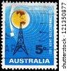 AUSTRALIA - CIRCA 1965: A Stamp printed in AUSTRALIA shows the Radio Mast and Satellite Orbiting Earth, circa 1965 - stock photo