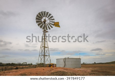 Australian outback old  retro wind powered water pump and storage tank
