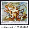 AUSTRIA - CIRCA 1968: a stamp printed in the Austria shows Vanquished Demons, by Paul Troger, Altenburg Abbey, circa 1968 - stock photo