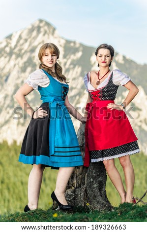 Austrian Women with traditional clothes in the Alps