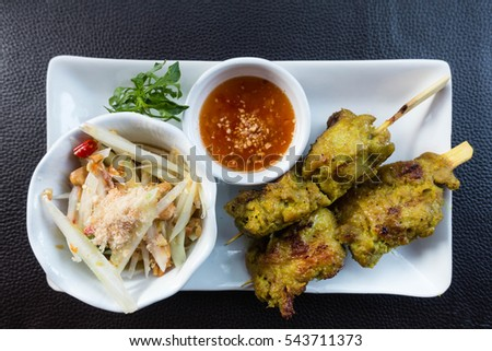 Authentic  thai food taken outdoor in natural lights, useful for exotic food concepts