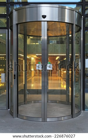 Automatic revolving door at office building
