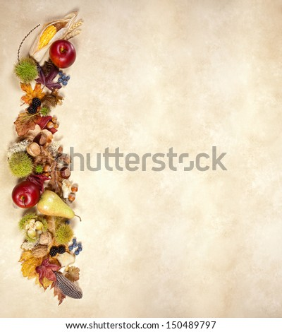 Autumn fruits leaves and nuts on jute