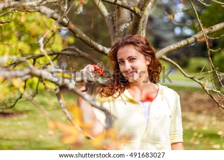 Autumn portrait with ashberry