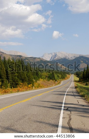 Autumn scenic view of rocky mountains and road (highway 40) while traveling in kananaskis country, alberta, canada