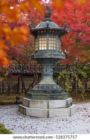 Autumn vivid color in a peaceful garden and Japanese style zen-like atmosphere scenery in Buddhist temple in Kyoto, Japan.