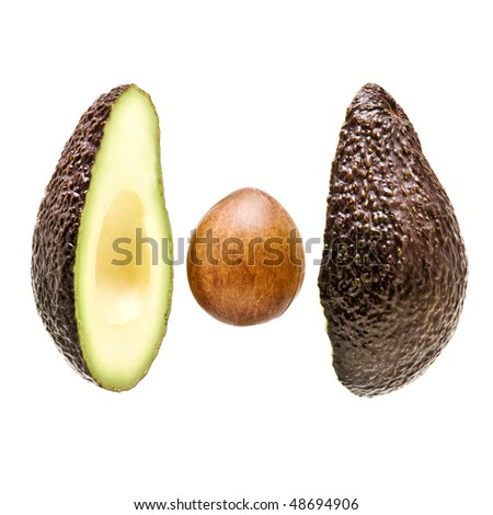 avacado sliced on white background with stone in centre