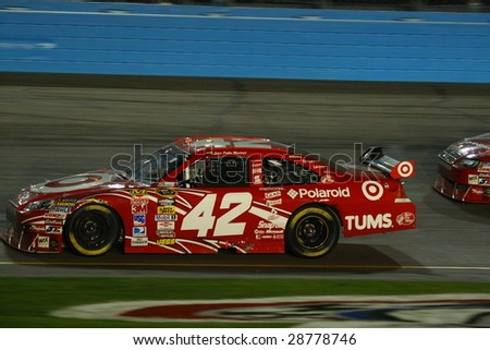 AVONDALE, AZ - APRIL 18: Juan Pablo Montoya brings the No. 42 Target Chevrolet down low in turn one during the NASCAR Sprint Cup Series race on April 18, 2009