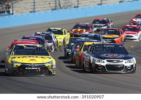 Avondale, AZ - Mar 13, 2016: Carl Edwards (19) and Kevin Harvick (4) races off turn four during the Good Sam 500(k) at the Phoenix International Raceway in Avondale, AZ.