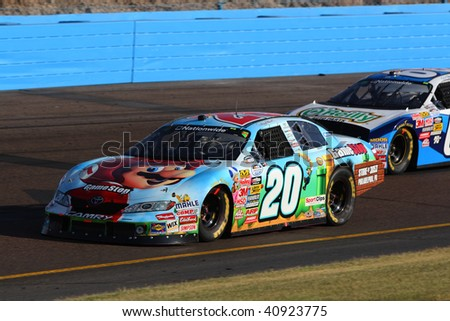 AVONDALE, AZ - NOVEMBER 14: Denny Hamlin (20) fights for position in the NASCAR Nationwide Series, Able Body Labor 200 at Phoenix International Raceway on November 14, 2009 in Avondale, AZ.