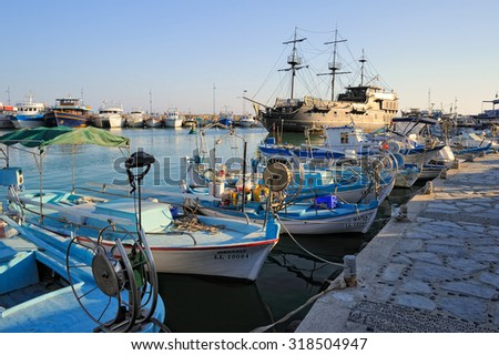 Ayia Napa, Cyprus - 3 September, 2015: Pleasure boat, a replica of the famous Black Pearl anchored surrounded by fishing boats in the bay of Ayia Napa