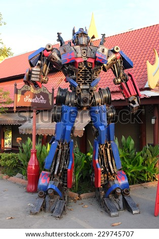 AYUTTAYA,THAILAND - NOVEMBER 8, 2014 : The Replica of Optimus Prime robot made from iron part of a Car display at Thung Bua Chom floating market