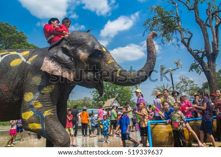 AYUTTHAYA, THAILAND - APR 13: Revelers and elephants join in water splashing during Songkran Festival on Apr 13, 2016 in Ayutthaya, Thailand. The water festival has been observed as Thai New Year.