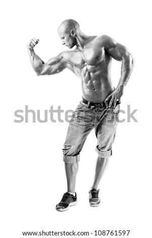 B&W Muscled male model posing in studio at white background