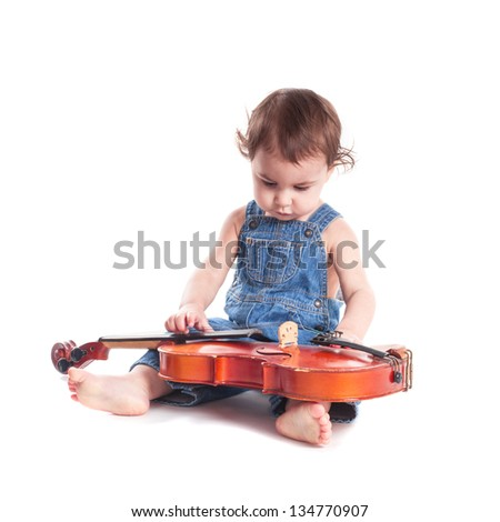 baby and violin isolated on white. Choosing future profession