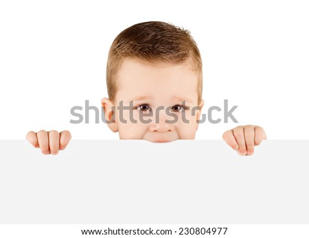 Baby boy holding white blank board isolated on white background