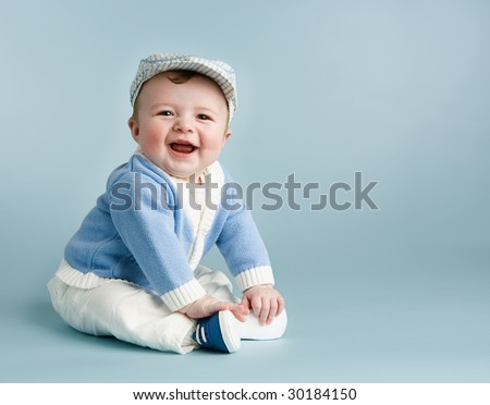 baby boy on blue laughing