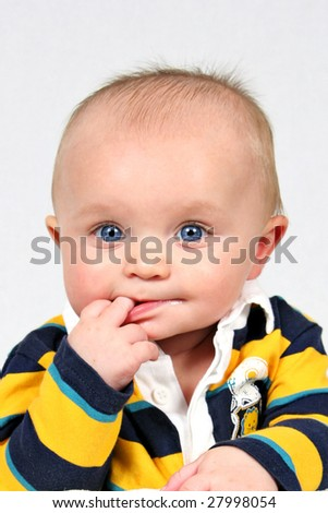 Baby boy taken closeup with finger in mouth