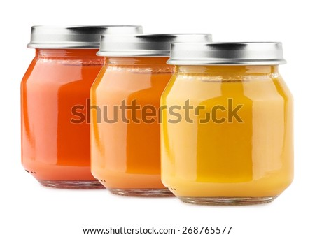 Baby food in glass on white background