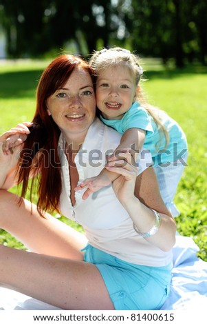 Baby girl and mother in the park