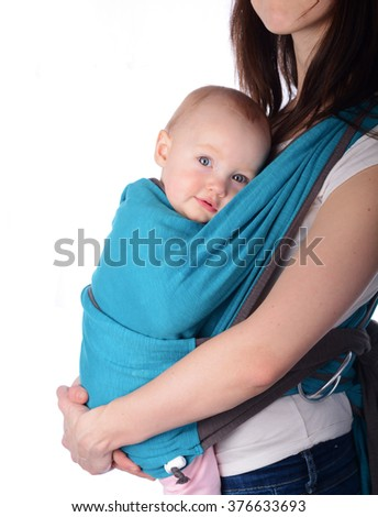 Baby girl in a carrier